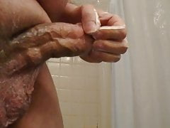 Fat man jerks cock with lotion and cums
