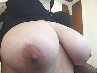Latina with cute braids spits on big tits and masturbates
