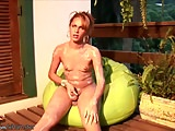 Oiled up feminine shemale with puffy nipples jerks and cums