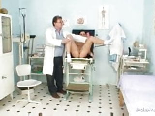 Gyno doctor speculum examines Sandra at kinky gyno clinic