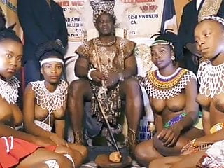 African chief with his own topless girls...