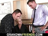 Skinny old blonde swallows two cocks for work