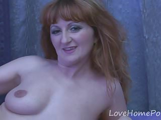 Mature redhead is proud of body...
