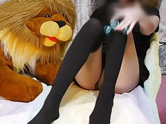 A girl wearing a pantyhose plays with a toy lion to music