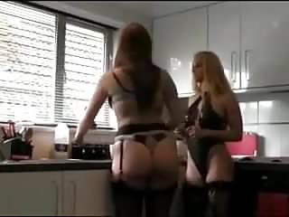 Two housewives, they talk a little to each other.