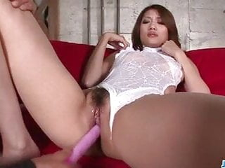 Riina Fujimoto moans with toys in both her holes