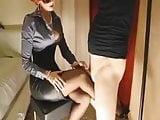 Mature redhead gives her slave slut a footjob