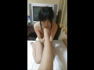 Chinese mistress gets her pussy and feet licked...