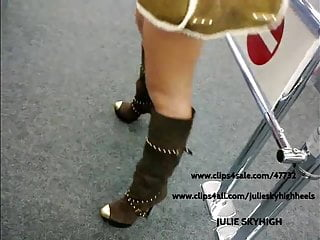sexy girl in public shop in sexyboots...