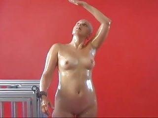bald oiled girl standing