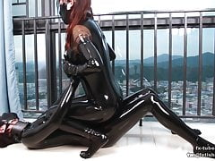 Latex lesbian rubbing and stroking for orgasm