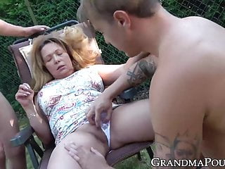 outdoors lady sucks Mature while cock fingered young