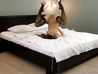 Flexible girl posing & spreading her legs on a bed