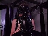 Bondage Latex girl locked in box