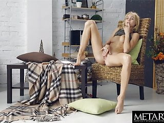 Blonde masturbates as she watches sexy movie of...