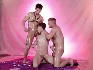 Oiled up threesome...