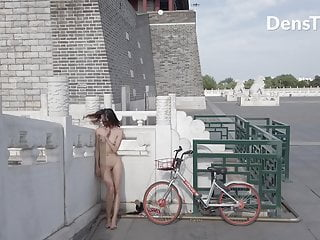 Chinese girl walk nude old monument public street...