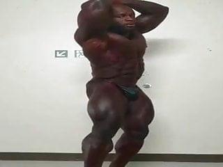Huge bodybuilder flexing...