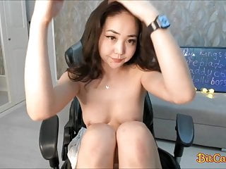 Pretty asian girl plays with toy