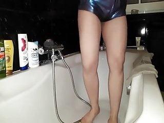 Twerking pissing in shiny hotpants
