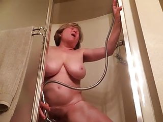 mature woman with a shower head