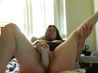 Fat glasses fucking herself with huge dildo...