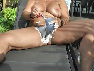 Busty blonde shaves her pussy outdoors...